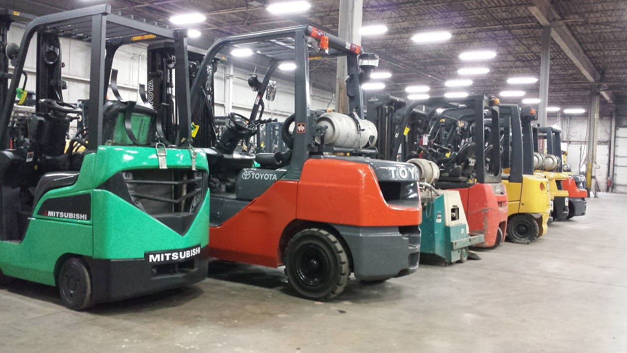 Used forklifts in Kensar warehouse being readied for sale