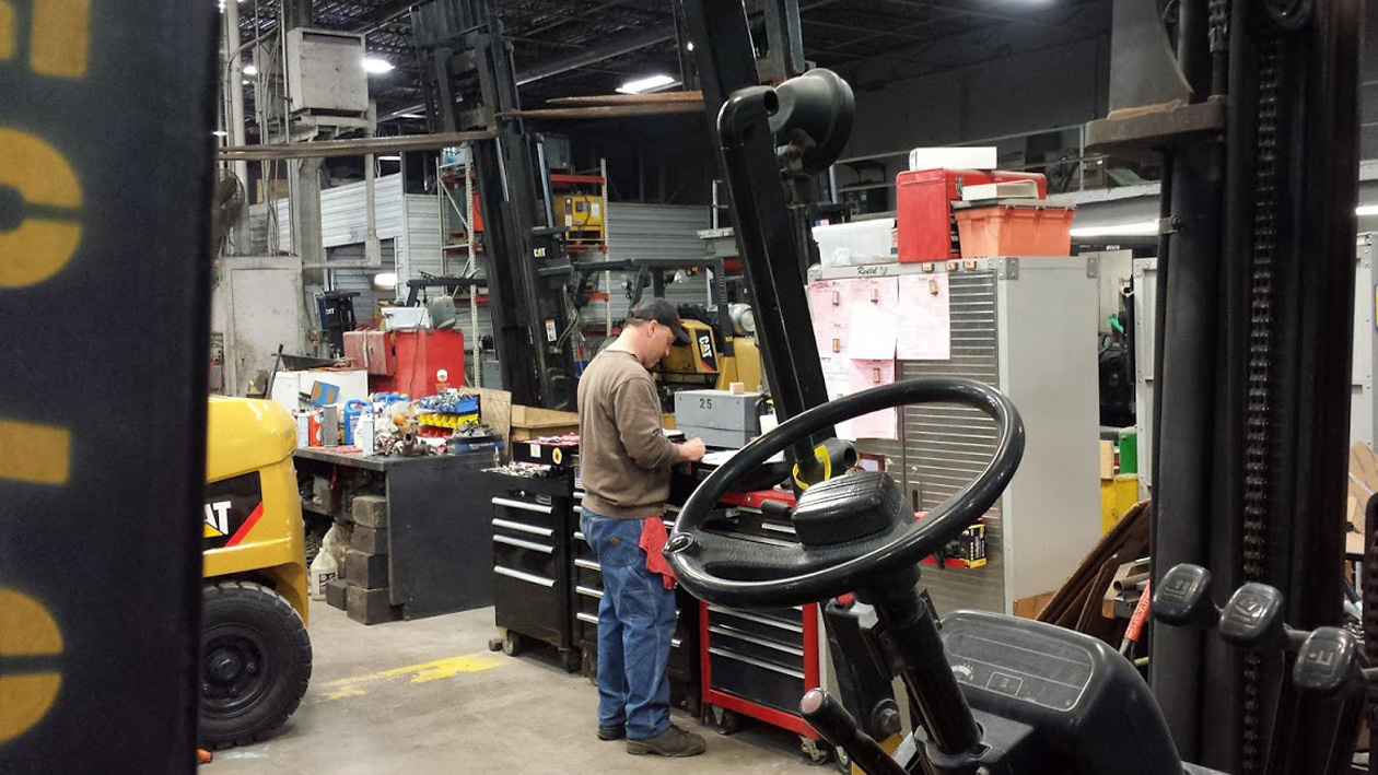 Well-equipped Kensar service facility preps used equipment prior to sale