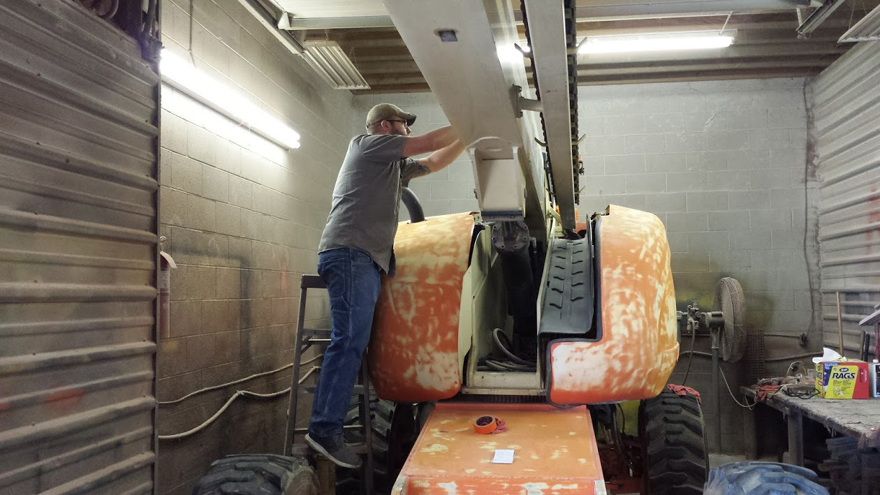 Used equipment from Kensar, like this JLG boom lift, can be painted prior to sale in this full-service shop