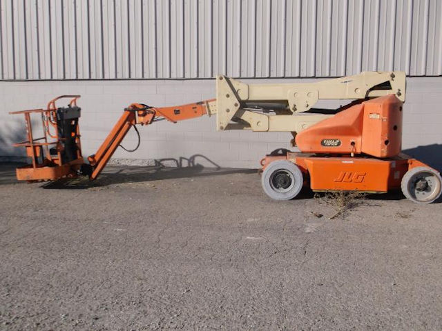 Used JLG E400AJP Articulated Boom Lift for sale at Kensar Equipment. 500lb capacity, 48v electric with 46ft Working Height.