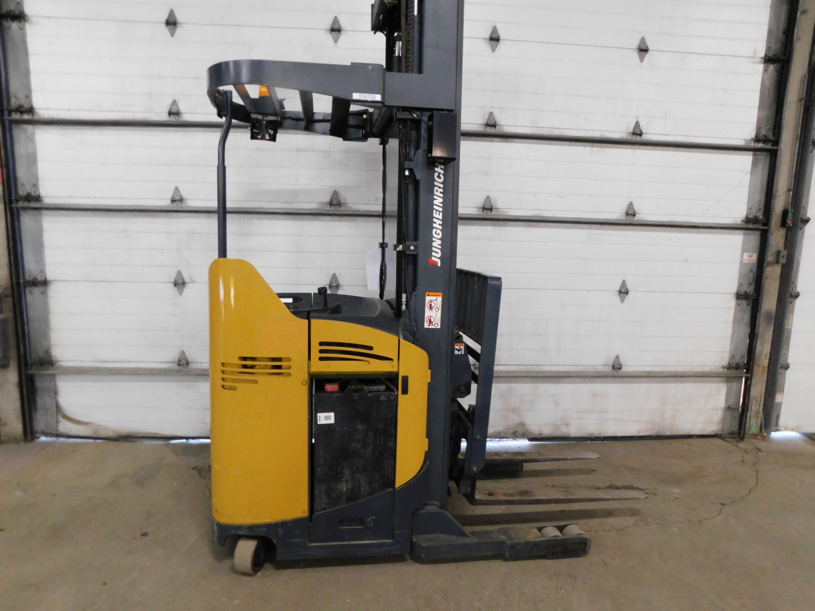Used Electric Reach Truck for sale. 4000lb stand up forklift.
